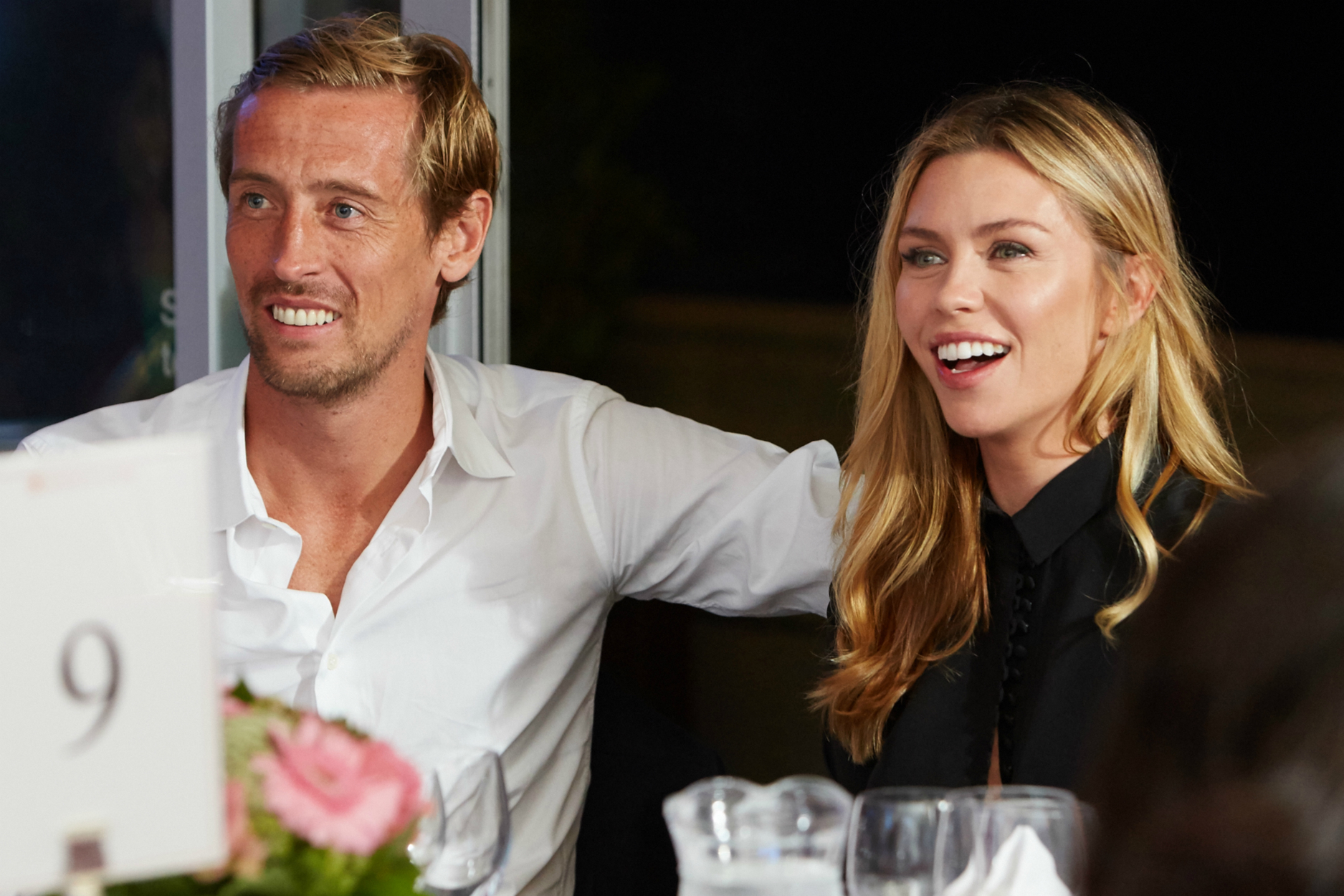 Premier League footballer Peter Crouch and his wife, model and TV presenter, Abbey Clancy enjoying a lighter moment at the gala dinner to launch SpringBoard.